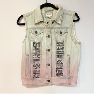 Denim vest with sewn in tribal pattern
